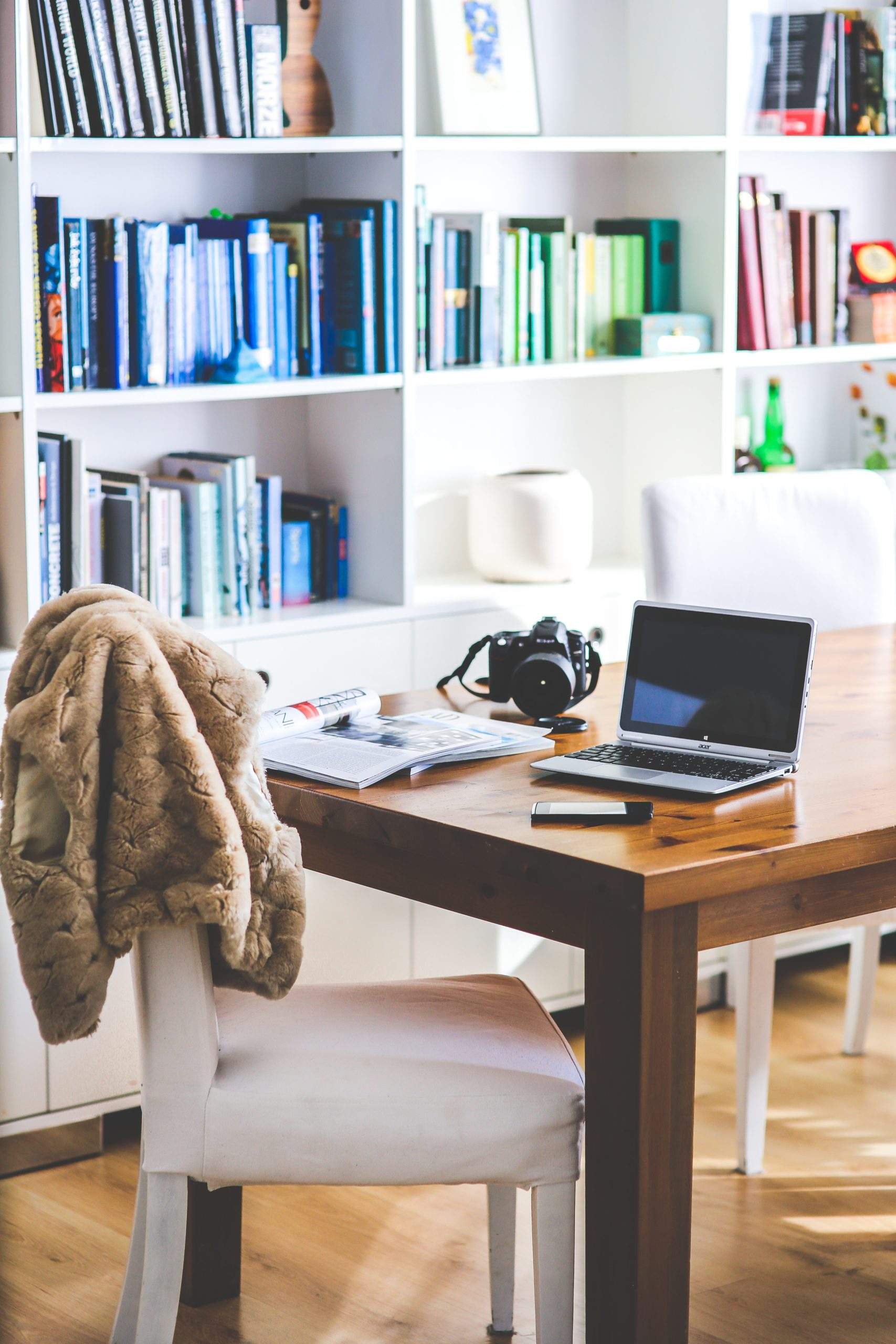 an improved home office with built in shelving